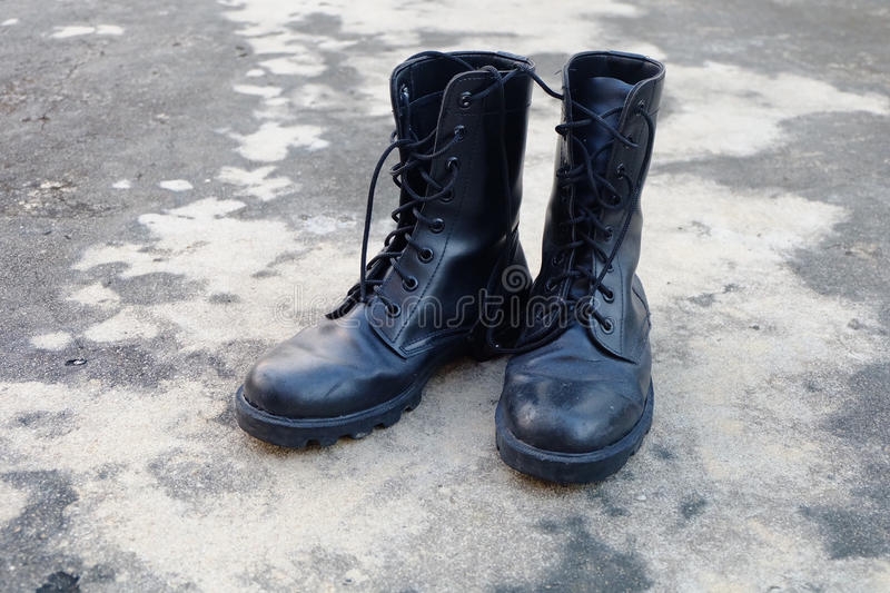 Pair of Black old Army Working Boots on Floor royalty free stock photos
