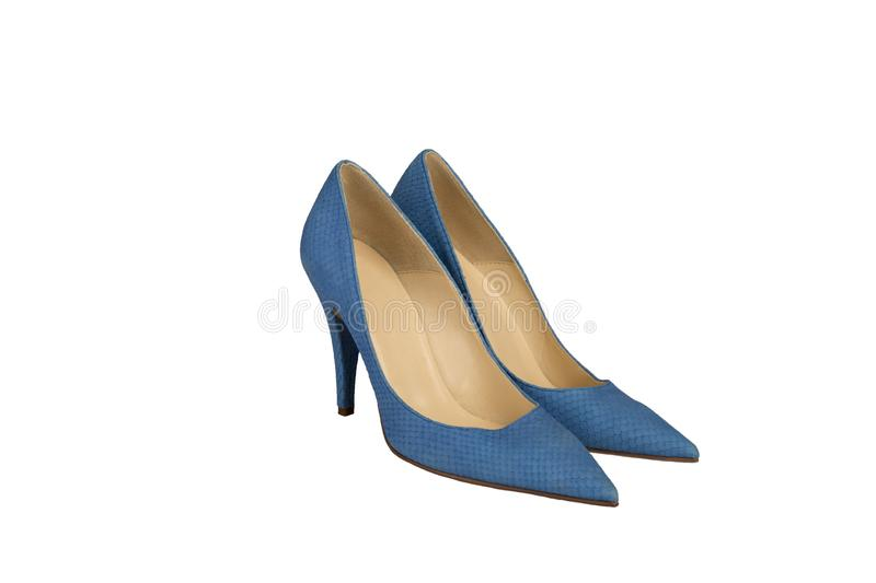 Pair of blue female shoes with snake skin texture imitation on high heels on white background stock photo