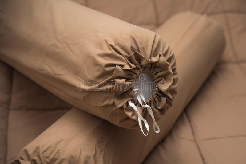 Pair of bolster. Close up of brown bolster on the brown blanket royalty free stock image