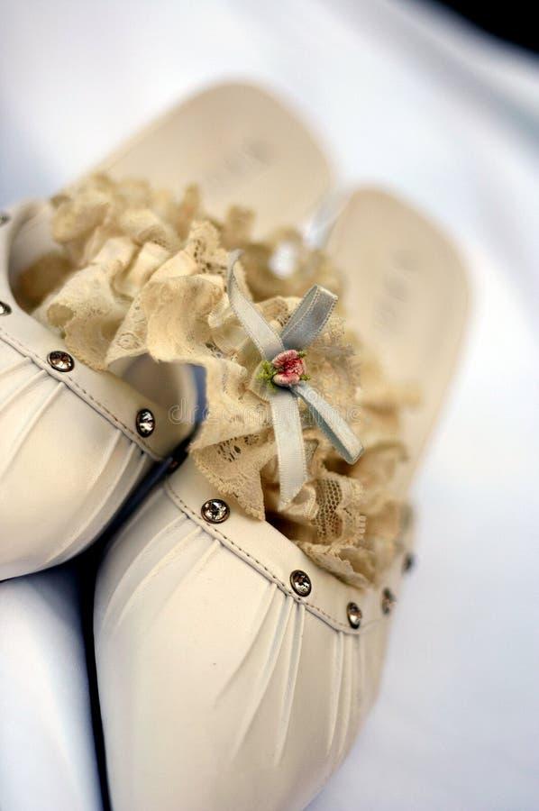 Pair of bridal shoes stock photos