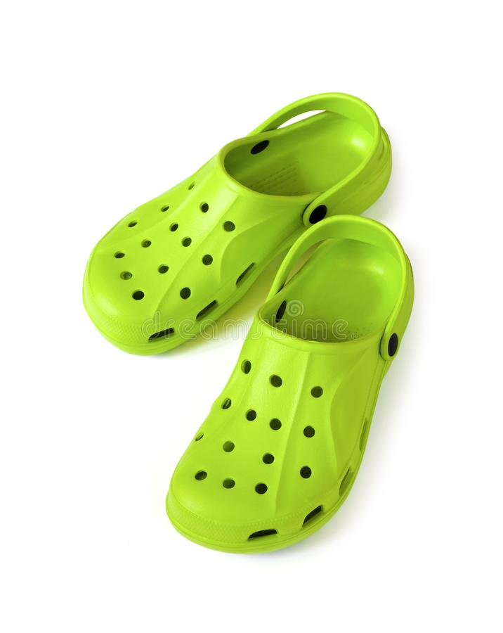 Pair of bright green clogs isolated on white background. With clipping path stock photo