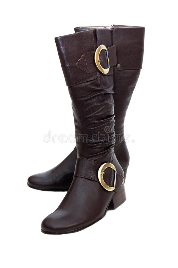 Pair of brown winter woman boots stock images