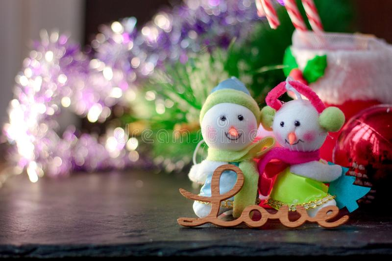 Pair of christmas snowmans with word Love near them. Pair of christmas snowmans with word Love near them royalty free stock photography