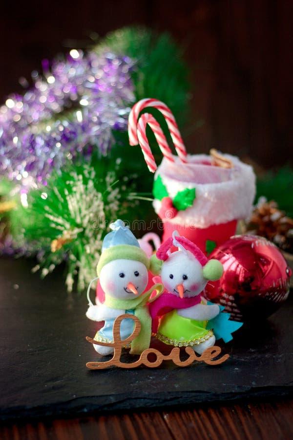 Pair of christmas snowmans with word Love near them. Pair of christmas snowmans with word Love near them stock photos