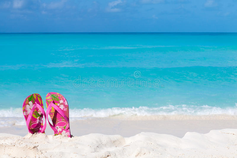 Pair Of Colored Sandals On A White Sand Beach Royalty Free Stock Images