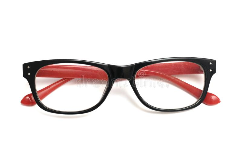 A pair of colorful decorative spectacles with red colored temples stock photography