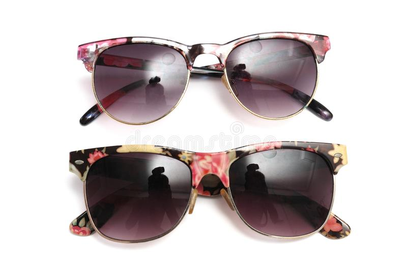 A pair of colorful flora retro funky sunshades stock photo