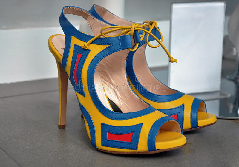 Pair of colorful high heel shoes. A pair of colorful high-heel shoes in store window royalty free stock photo