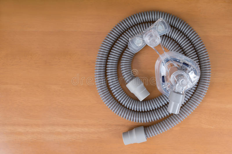 Pair of CPAP mask and tubing. stock photos