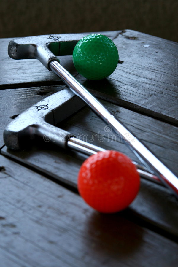Pair Of Crazy Golf Clubs With Golf Balls Stock Photo