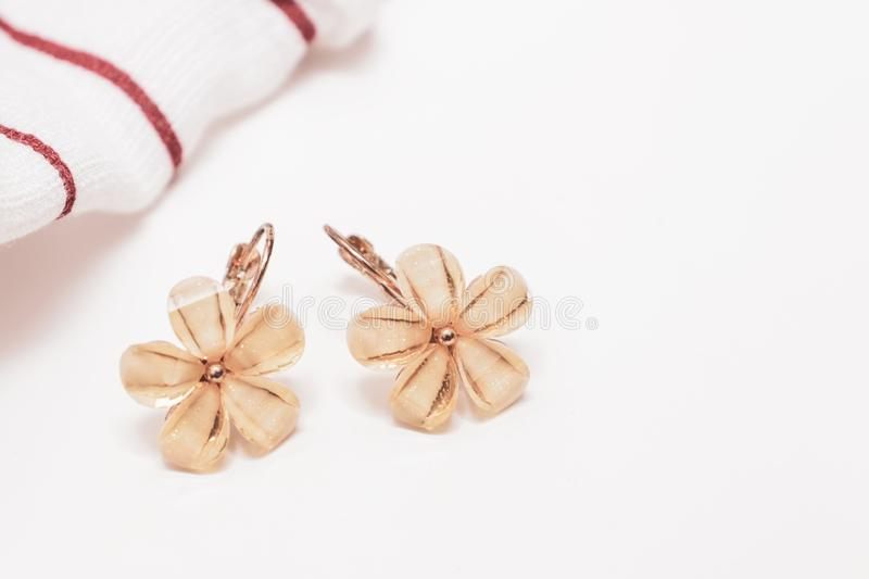 A pair of cristal flower form bijouterie earrings on white background with copy space stock photo