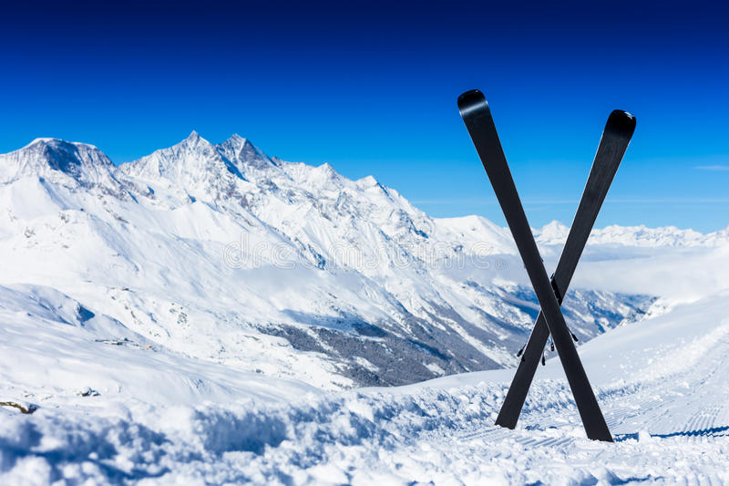 Pair of cross skis in snow royalty free stock photos