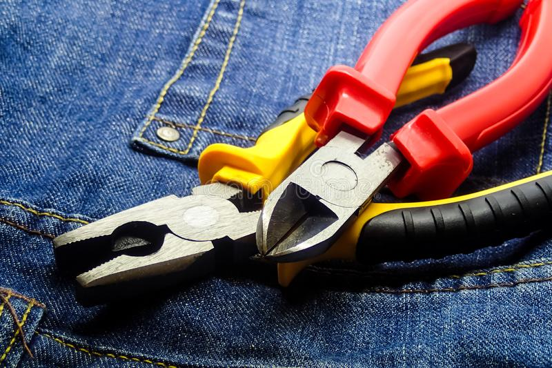 Pair cutting pliers hand tools electrician building closeup red yellow handle stock image
