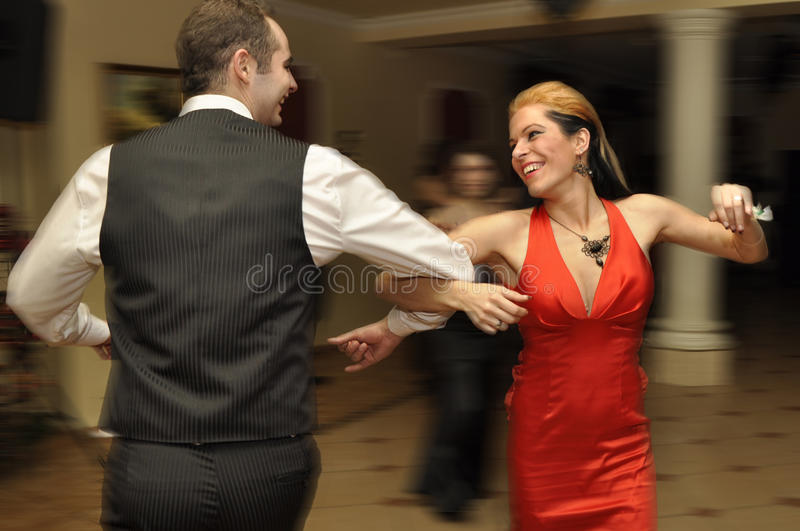 Pair is dancing. Lady in red is dancing on the party royalty free stock photos