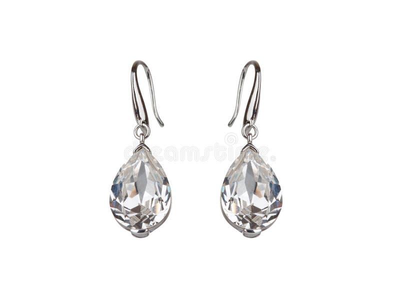 Pair of diamond earrings royalty free stock photo