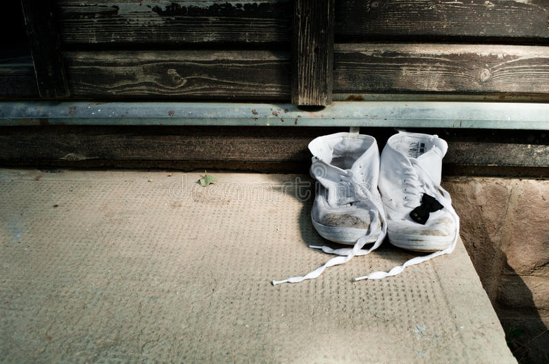 A pair of dirty shoes royalty free stock photos