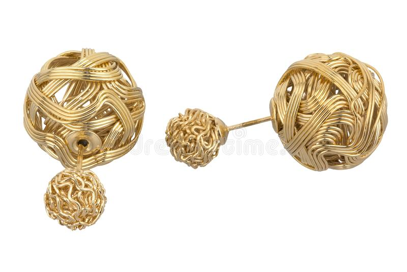 Pair of double golden earrings, made of two different sizes intricate weaven gold balls, isolated on white background, clipping. Path included royalty free stock photo