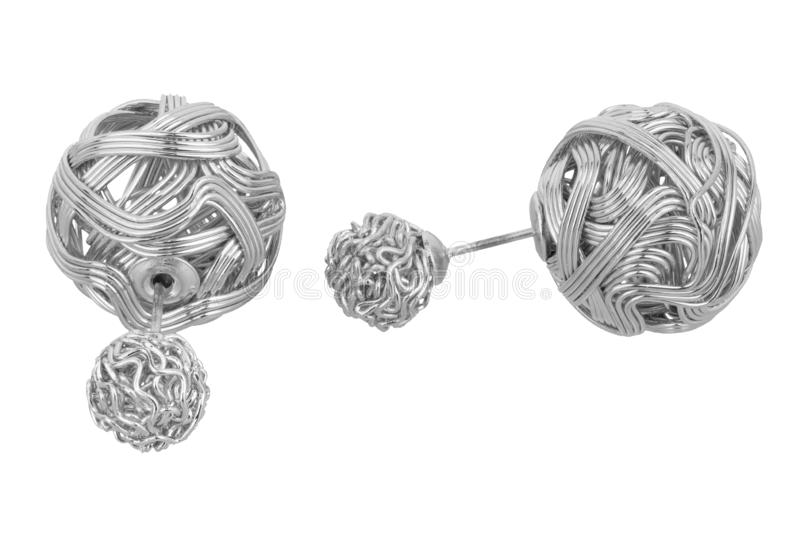 Pair of double silver earrings, made of two different sizes intricate weaven silver balls, isolated on white background, clipping. Path included stock photo