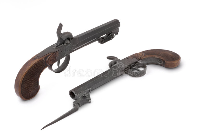 Pair duel cap guns (pistol) of the 19th century. With small bayonets. Belgium stock photography