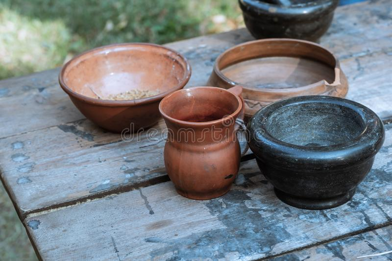 Pair earthenware dishes pot rustic dishes natural material background rustic on a wooden table royalty free stock photos