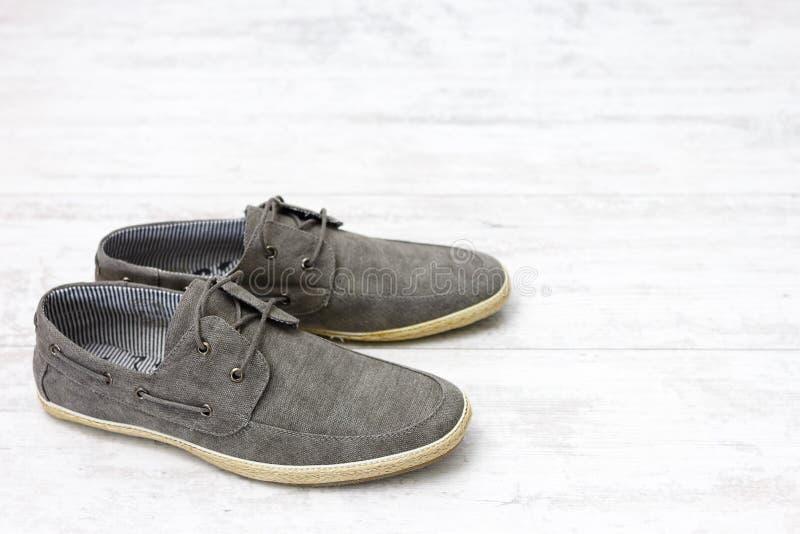 Pair Of Elegant Light Shoes On Wooden White Floor Stock Photo