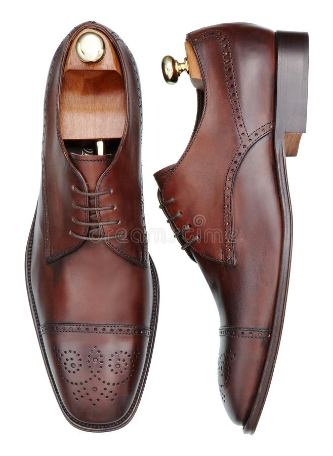 Pair of elegant mens shoes of brown leather royalty free stock photos