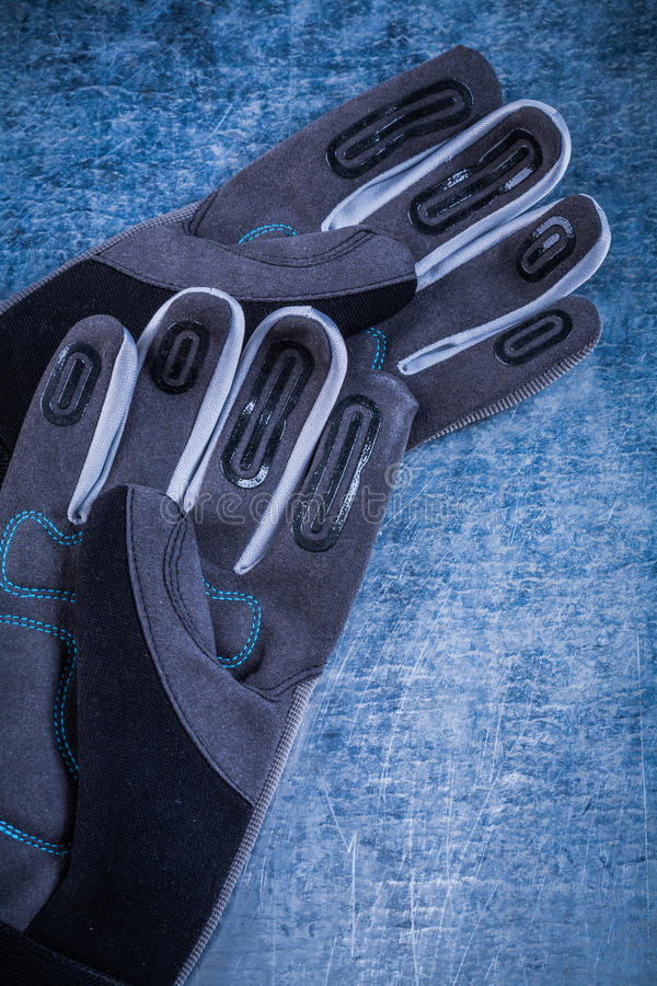 Pair of fabric working gloves on metallic surface agriculture co. Ncept stock photo