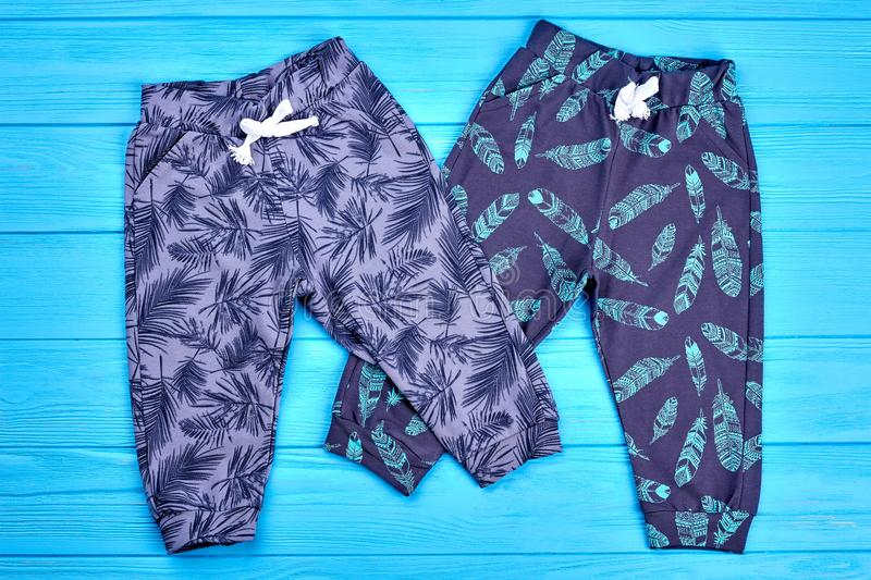 Pair of fashion design kids trousers. Brand cotton patterned pants for toddlers, top view. Children fashionable autumn apparel stock photo