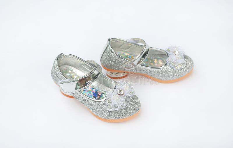 Pair of fashion princess shoes on white background. Baby shoes.  royalty free stock image