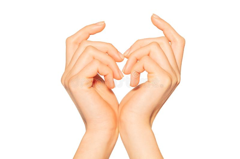 Pair of female hands making heart sign royalty free stock photography