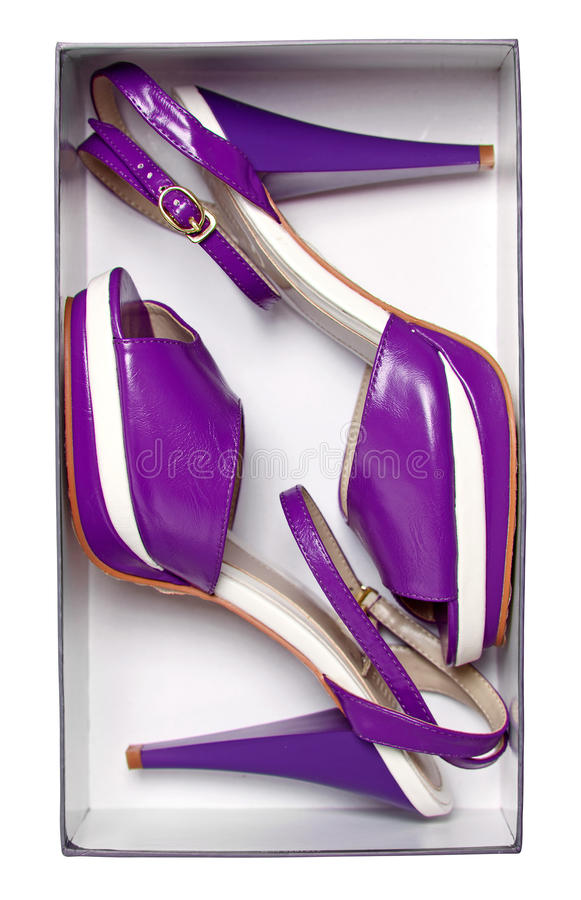 Pair of female violet summer shoes in box royalty free stock photos