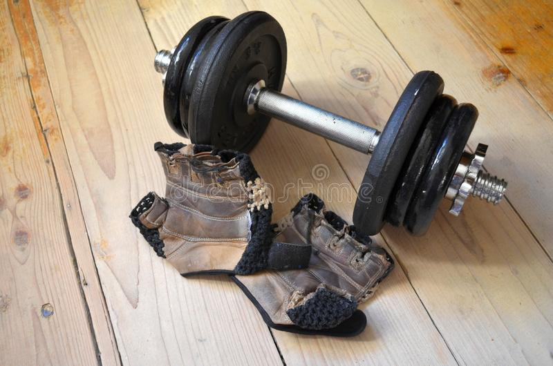 Pair of fitness gloves and dumbbells stock photography
