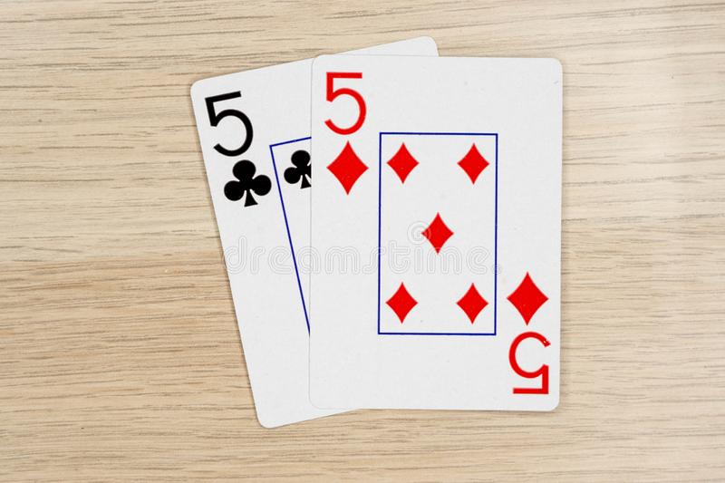 Pair of fives 5 - casino playing poker cards stock photography