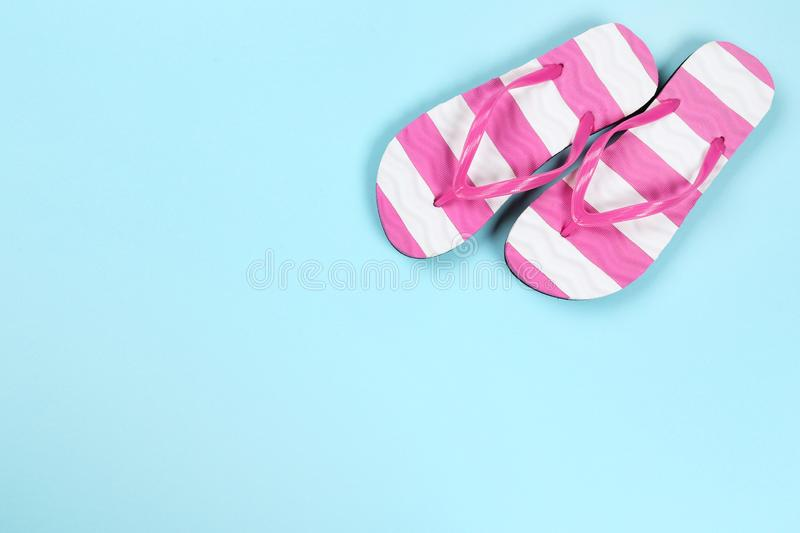 Pair of flip flops. On blue background royalty free stock photos