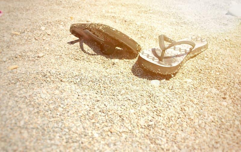 A pair of flip-flops. On a stony beach royalty free stock photos