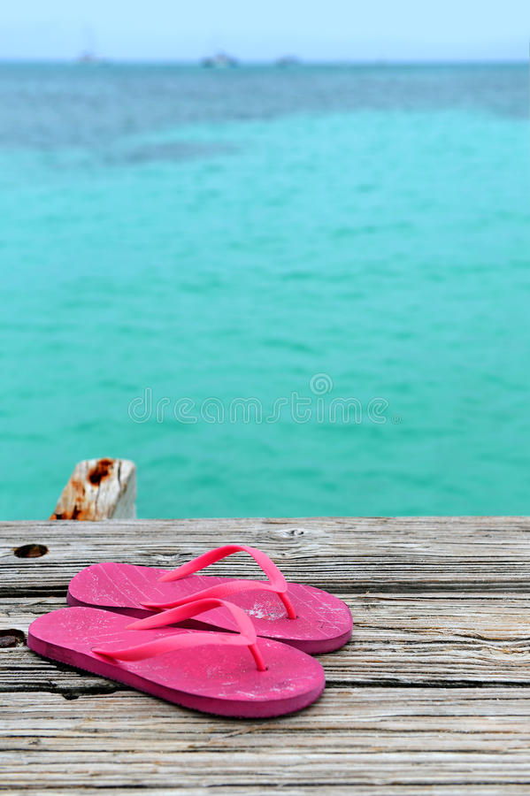 Download Pair of Flip Flops on Pier stock image. Image of water - 32276625