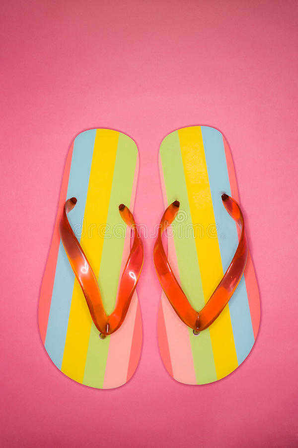 Pair of Flip flops on pink background stock image