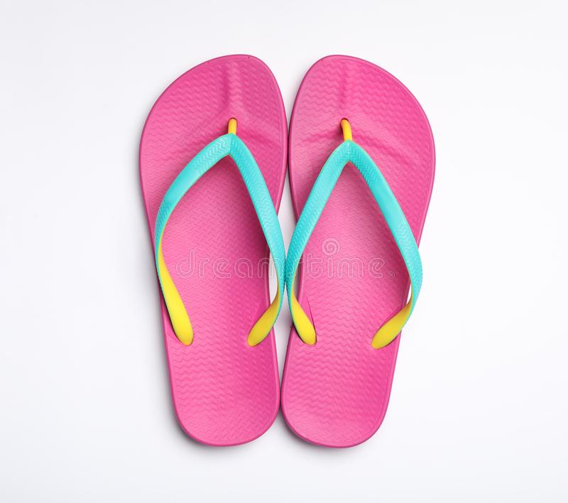 Pair of flip flops on white background. Beach accessories. Pair of flip flops on white background, top view. Beach accessories stock photos