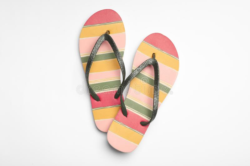 Pair of flip flops on white background. Beach accessories. Pair of flip flops on white background, top view. Beach accessories royalty free stock photography