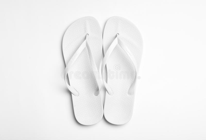 Pair of flip flops on white background. Beach accessories. Pair of flip flops on white background, top view. Beach accessories stock image