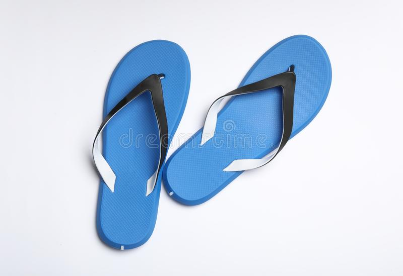 Pair of flip flops on white background. Beach accessories. Pair of flip flops on white background, top view. Beach accessories royalty free stock photo