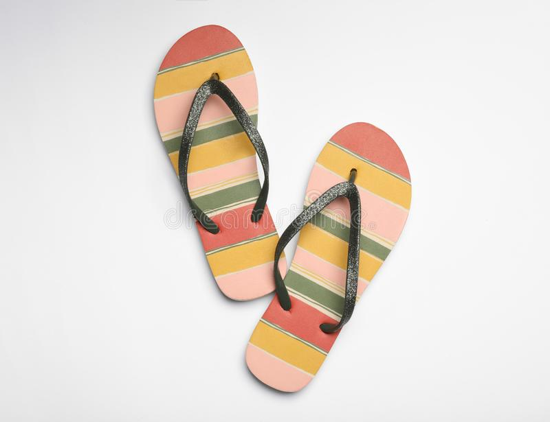 Pair of flip flops on white background. Beach accessories. Pair of flip flops on white background, top view. Beach accessories stock images
