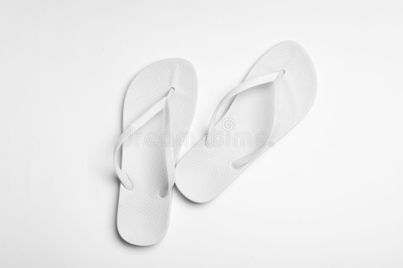 Pair of flip flops on white background. Beach accessories. Pair of flip flops on white background, top view. Beach accessories stock photo