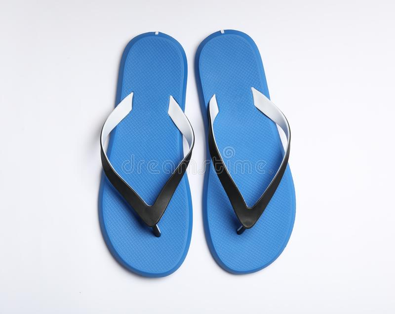 Pair of flip flops on white background. Beach accessories. Pair of flip flops on white background, top view. Beach accessories royalty free stock images