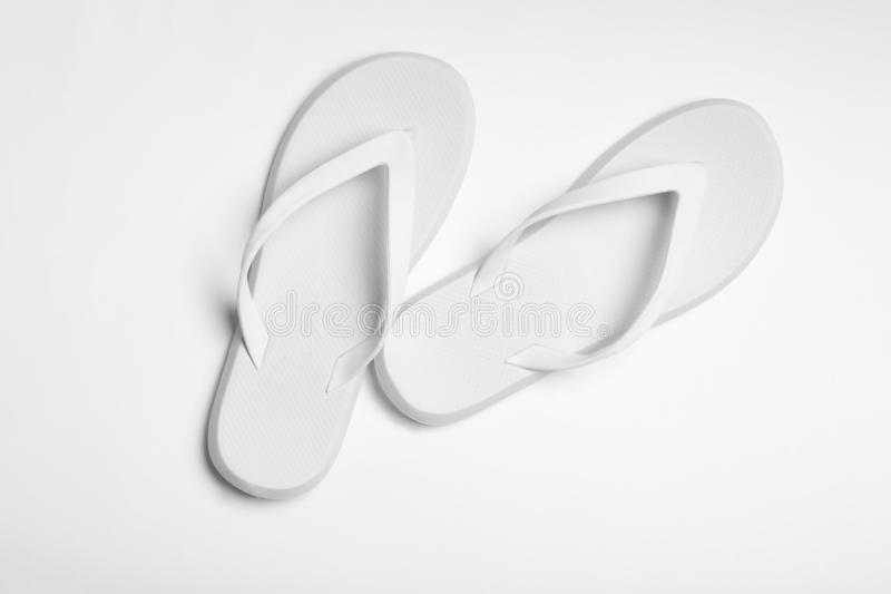Pair of flip flops on white background. Beach accessories. Pair of flip flops on white background, top view. Beach accessories royalty free stock image