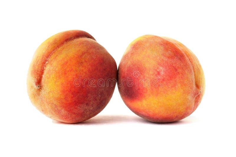 Pair of fresh peaches stock photo