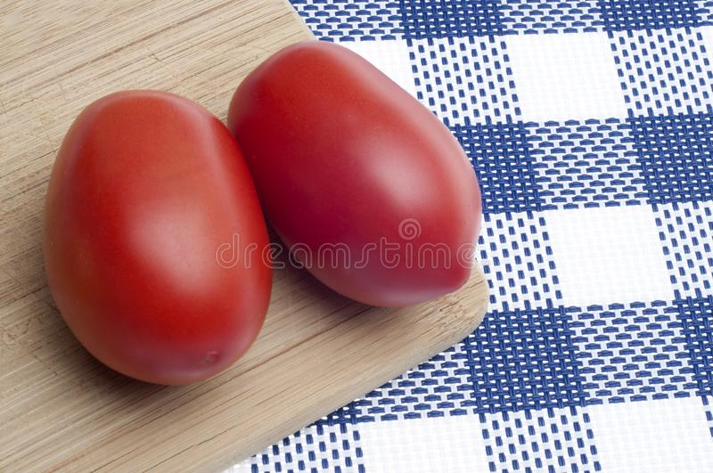 Pair of Fresh Roma Tomatoes stock images