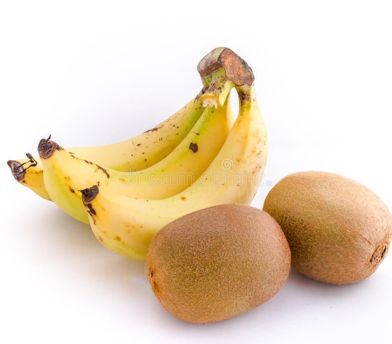 Pair of fruit, Kiwi and bananas on background royalty free stock photos