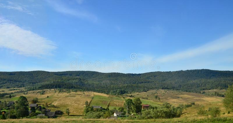 Photo of the Carpathian Mountains, which have a lot of coniferous trees. Forest and mountain landscape in the early autumn season stock photo