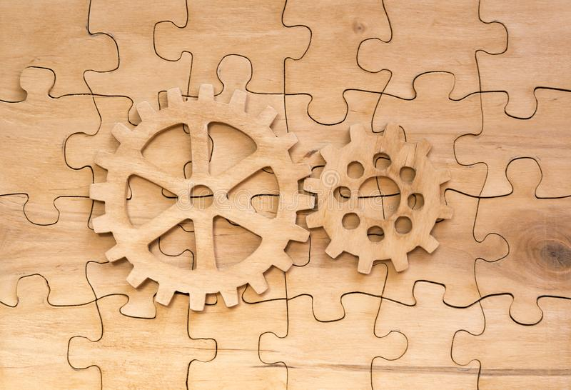 Pair of gears on the assembled group of puzzles stock images
